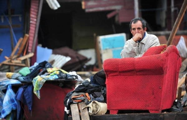 A man sits among his belongings