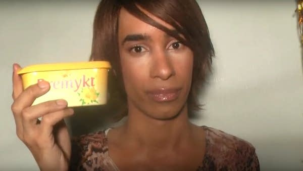 Screenshot of upset YouTuber TommyLife holding empty butter container