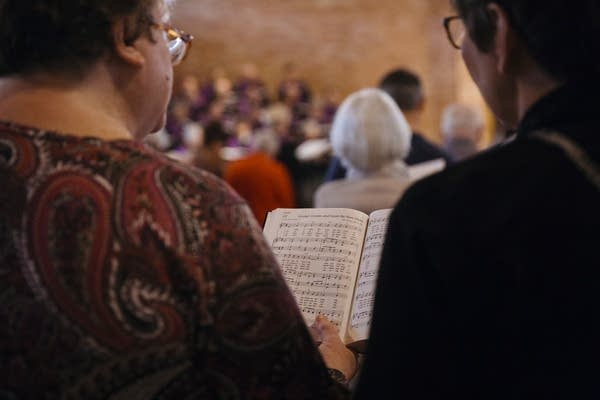 Parishioners sing from a hymnal at Mayflower church.