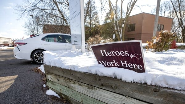 "A sign outside a building reads ""Heroes work here"""