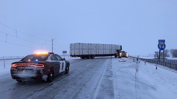 A jackknifed trailer blocks the westbound lanes of I-94