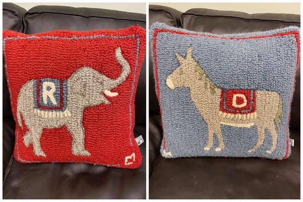 Two pillows, one with a donkey and another with an elephant.