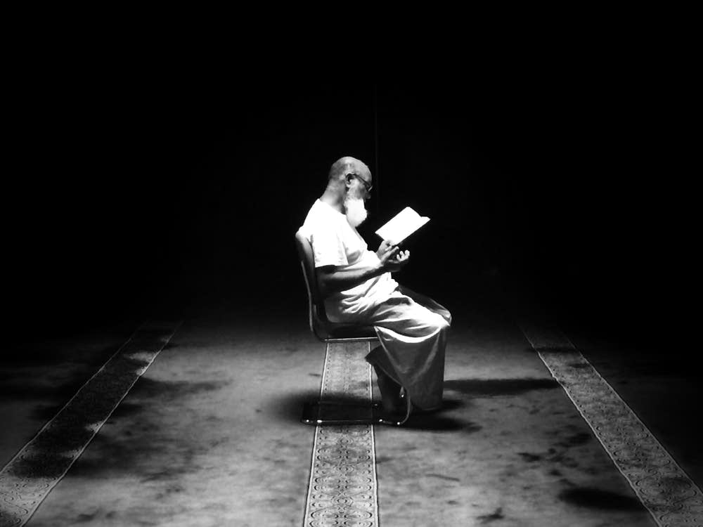 A Muslim man reads the Koran