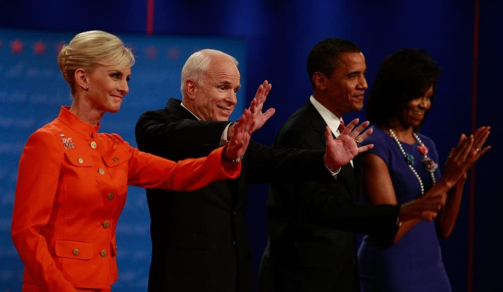 The candidates wave to the crowd after the debate