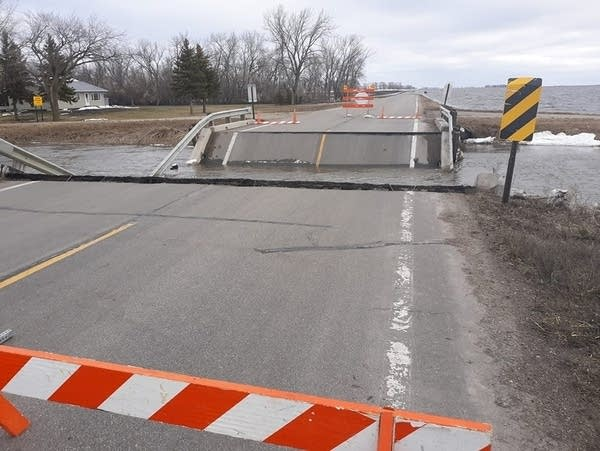 Rural Norman Co. bridge collapses in flood