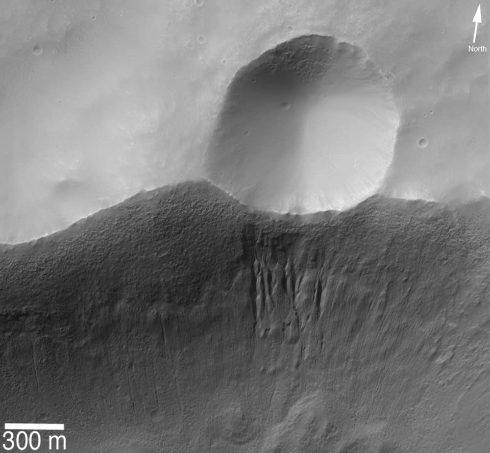 Gullies beneath a small crater on Mars