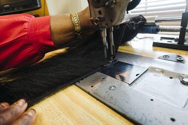 Joyce Iyawe sews a weft.