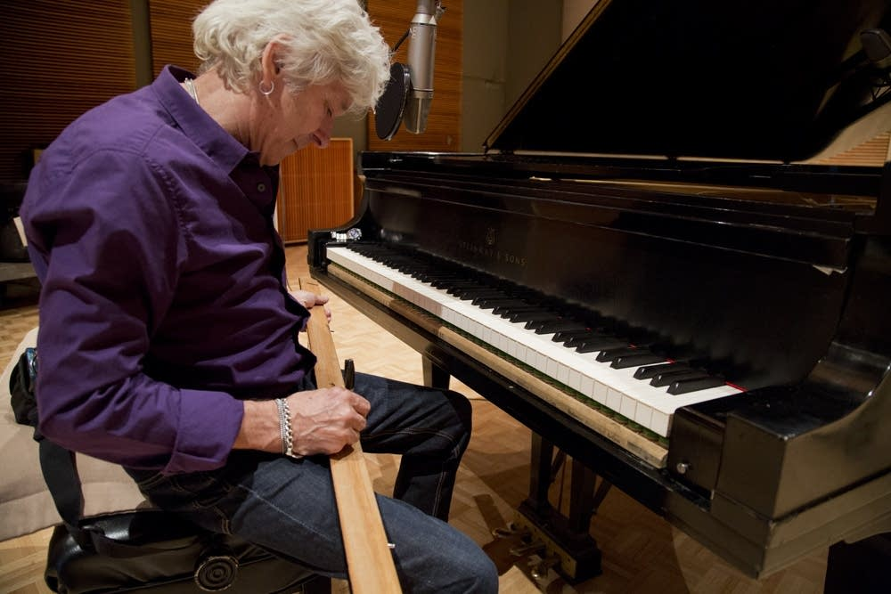 Ian McLagan signs piano