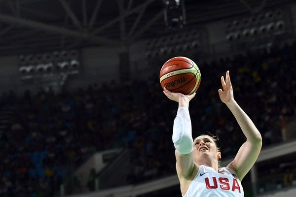 Lindsay Whalen goes to the basket during a gold medal basketball match.