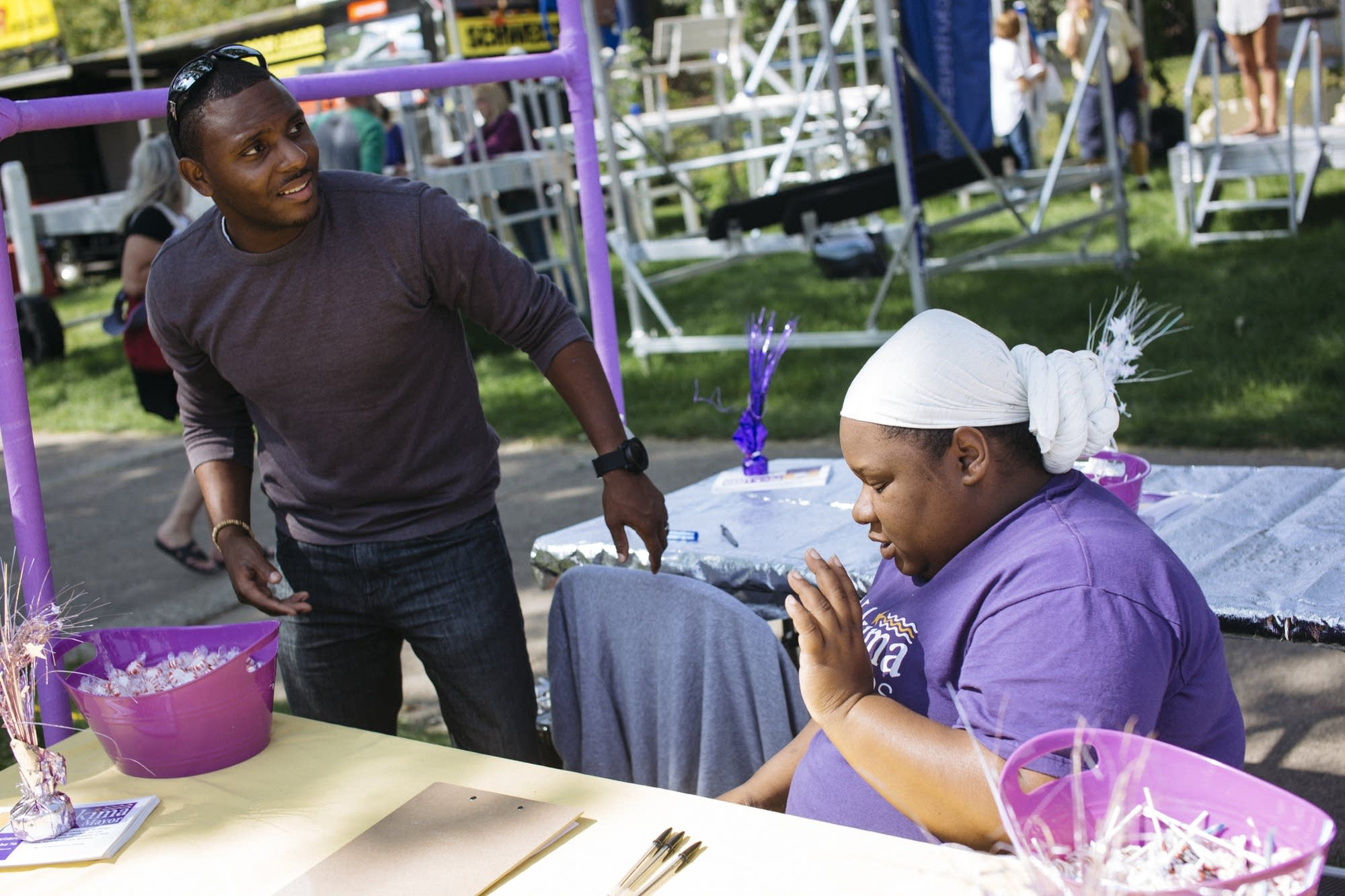 Elizer and Shaundelle Darris work a booth at the State Fair.