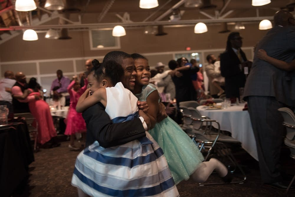 Melvin Carter gets hugs from his daughters.