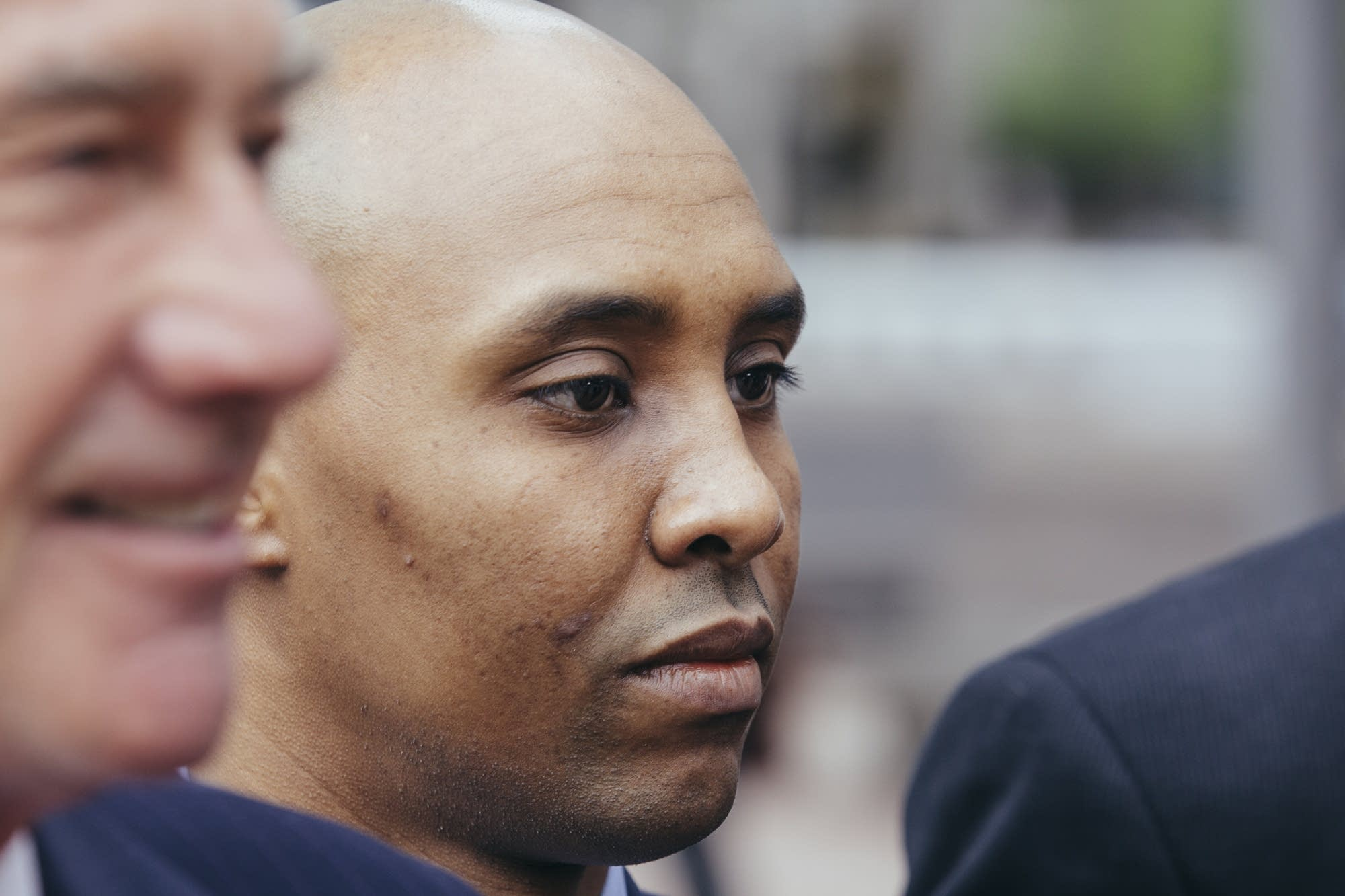 Mohamed Noor walks outside of the Hennepin County Government Center.