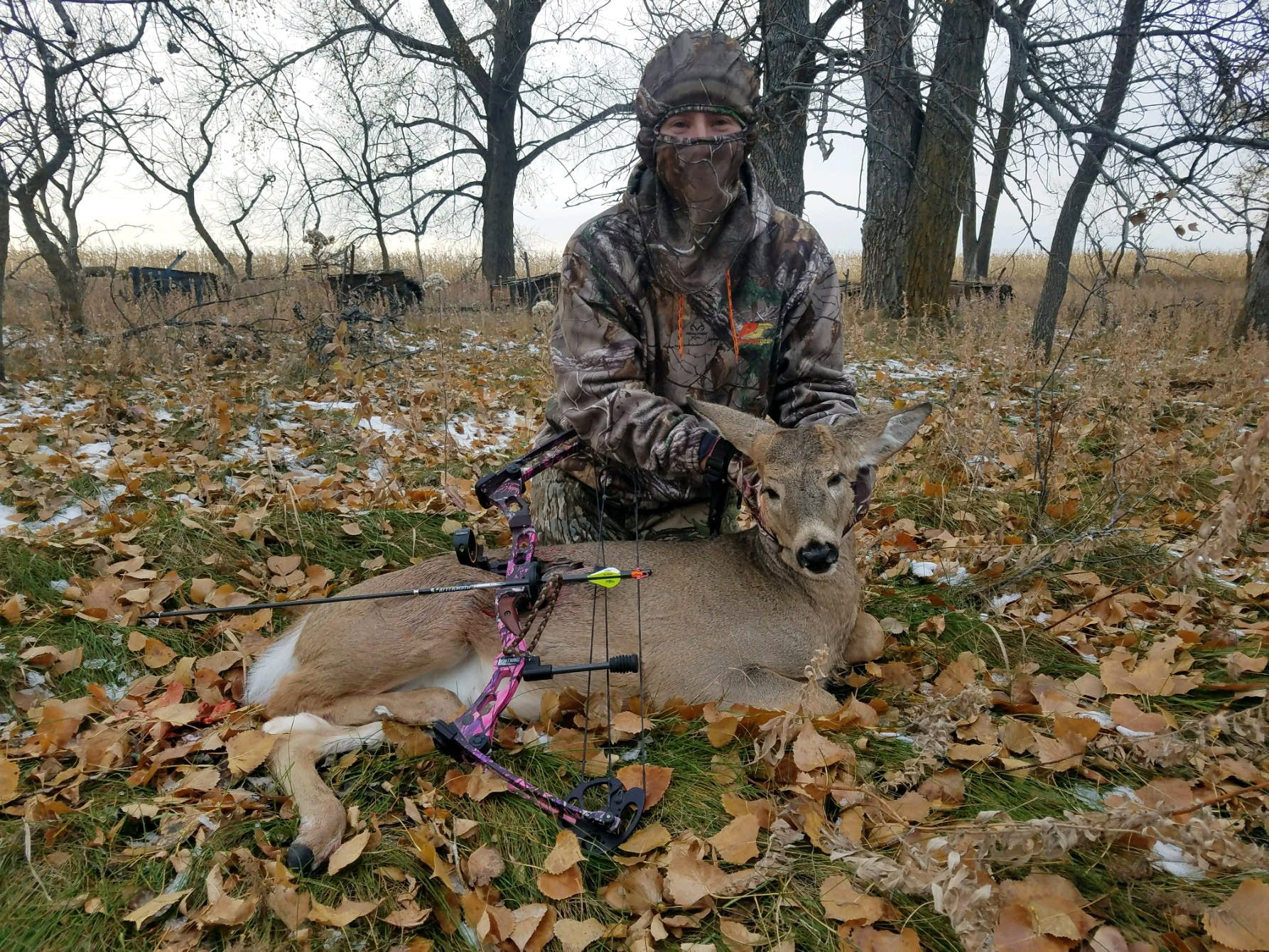 Misty Stoll with the deer she shot on Oct. 28.