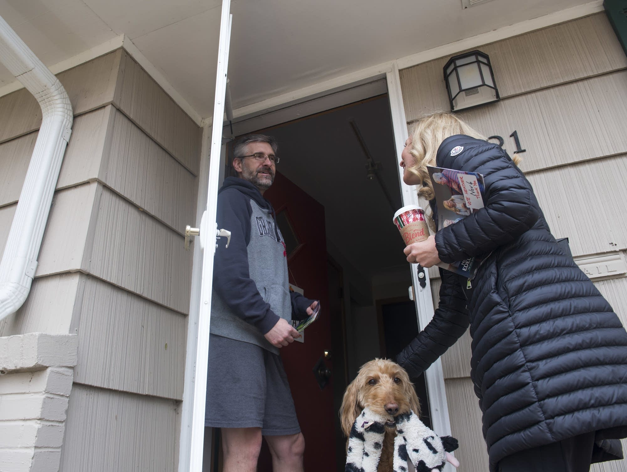 Heather Edelson speaks with Edina resident Rick Lackner, and his dog Penny
