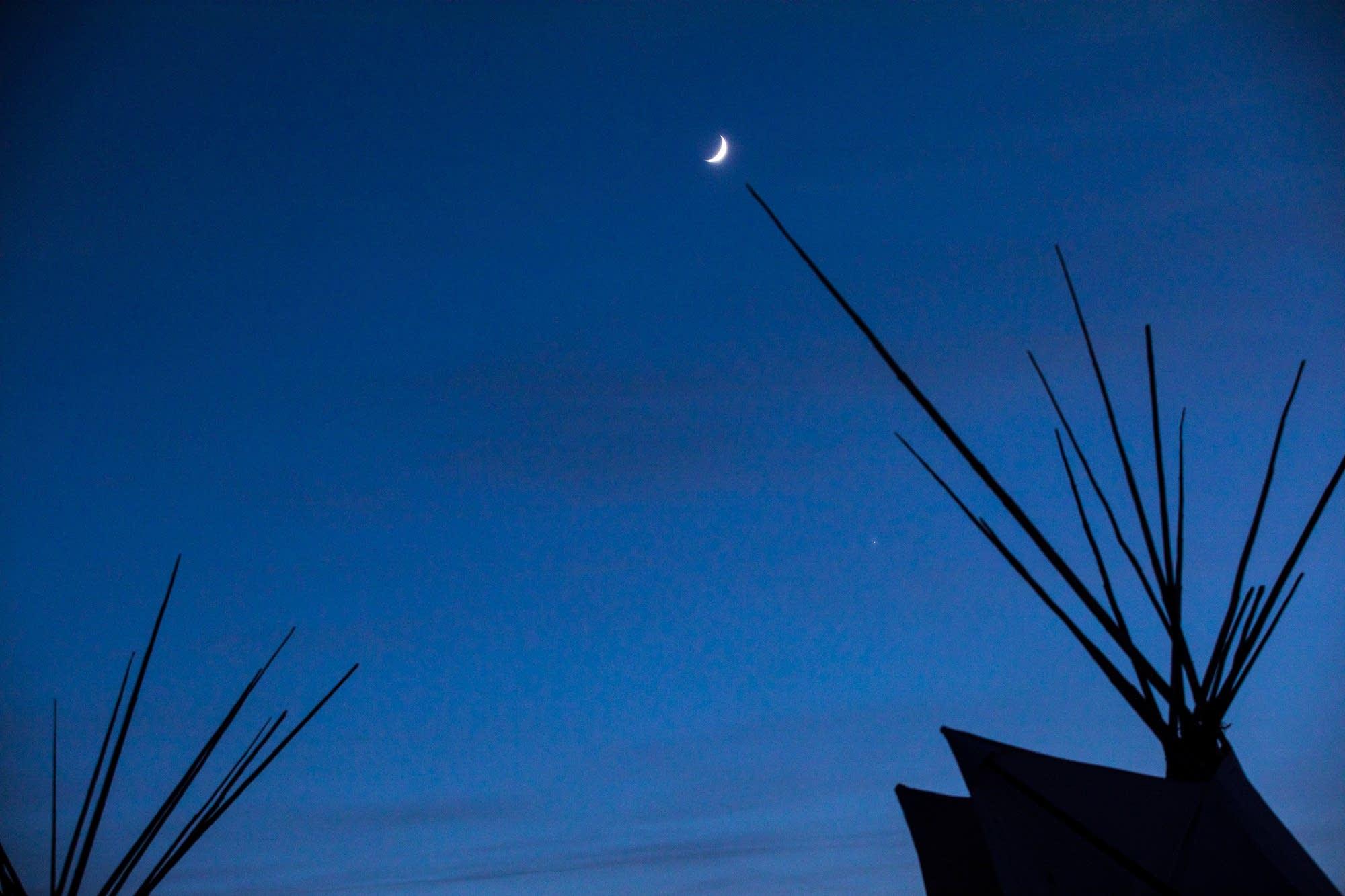 The moon over Oceti Sakowin.