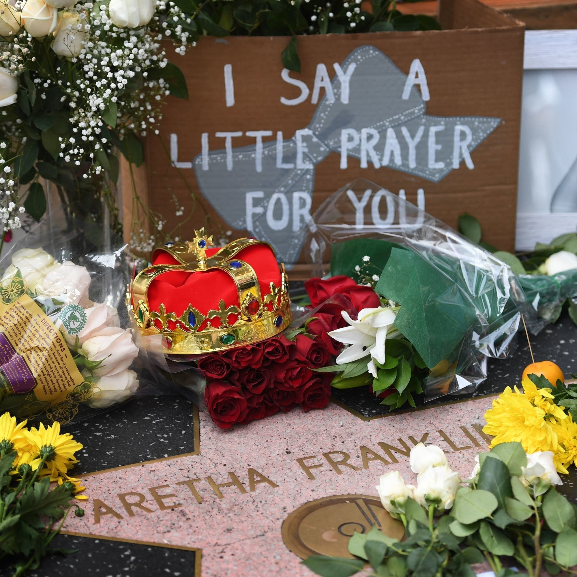 Tributes surround Aretha Franklin's star.