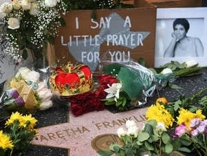 Tributes surround Aretha Franklin's star.