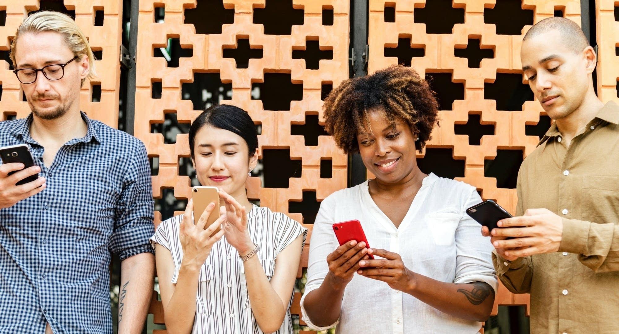 4 people on their phones