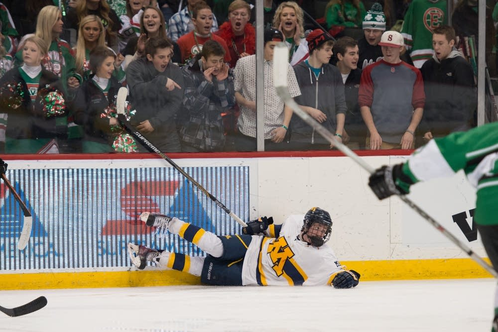 East Grand Forks fans taunted Mahtomedi player.