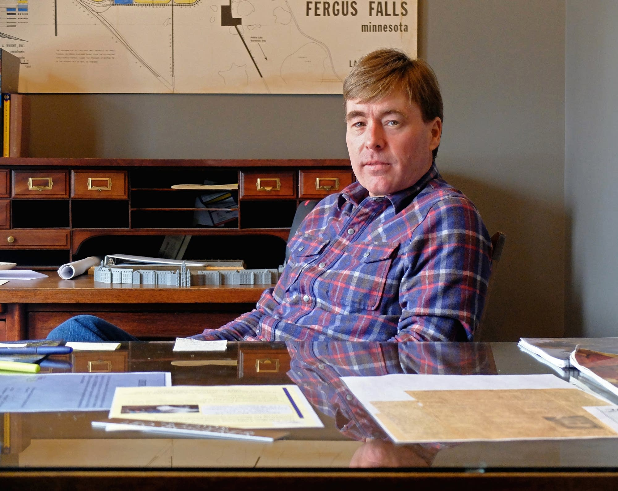 Fergus Falls Mayor Ben Schierer sits for a portrait in his office.