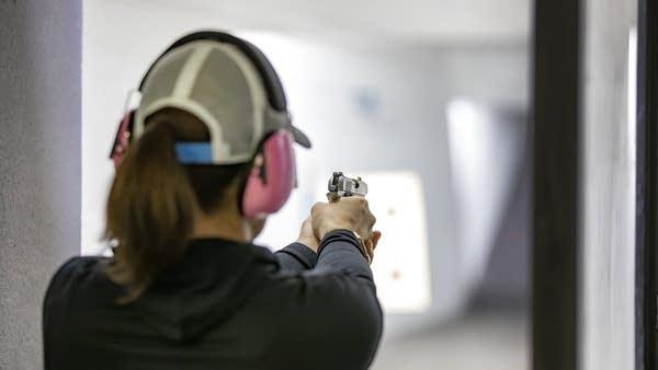 A woman at a shooting range.