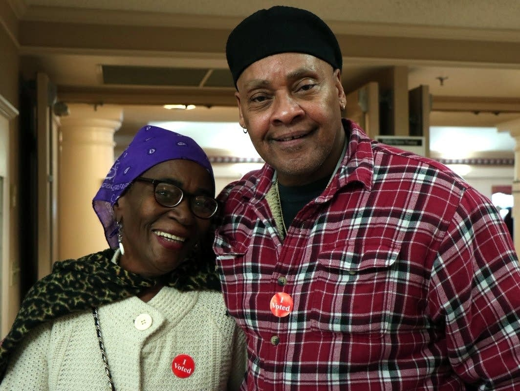 Linda Nyakundi, left, stands with James Rodgers after voting