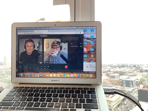 Laptop computer showing Luke and Andrew in Zoom-like screens
