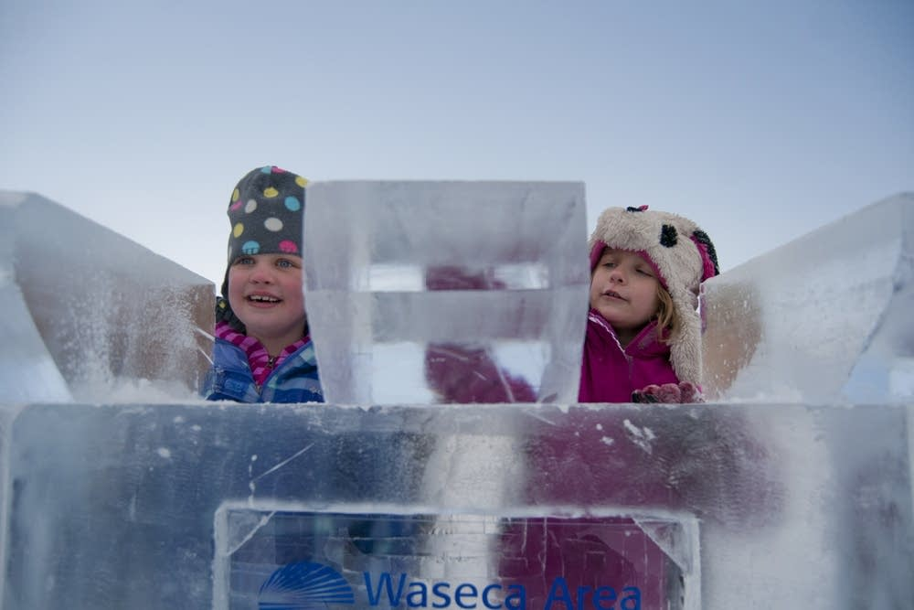 Kids play amongst an ice castle