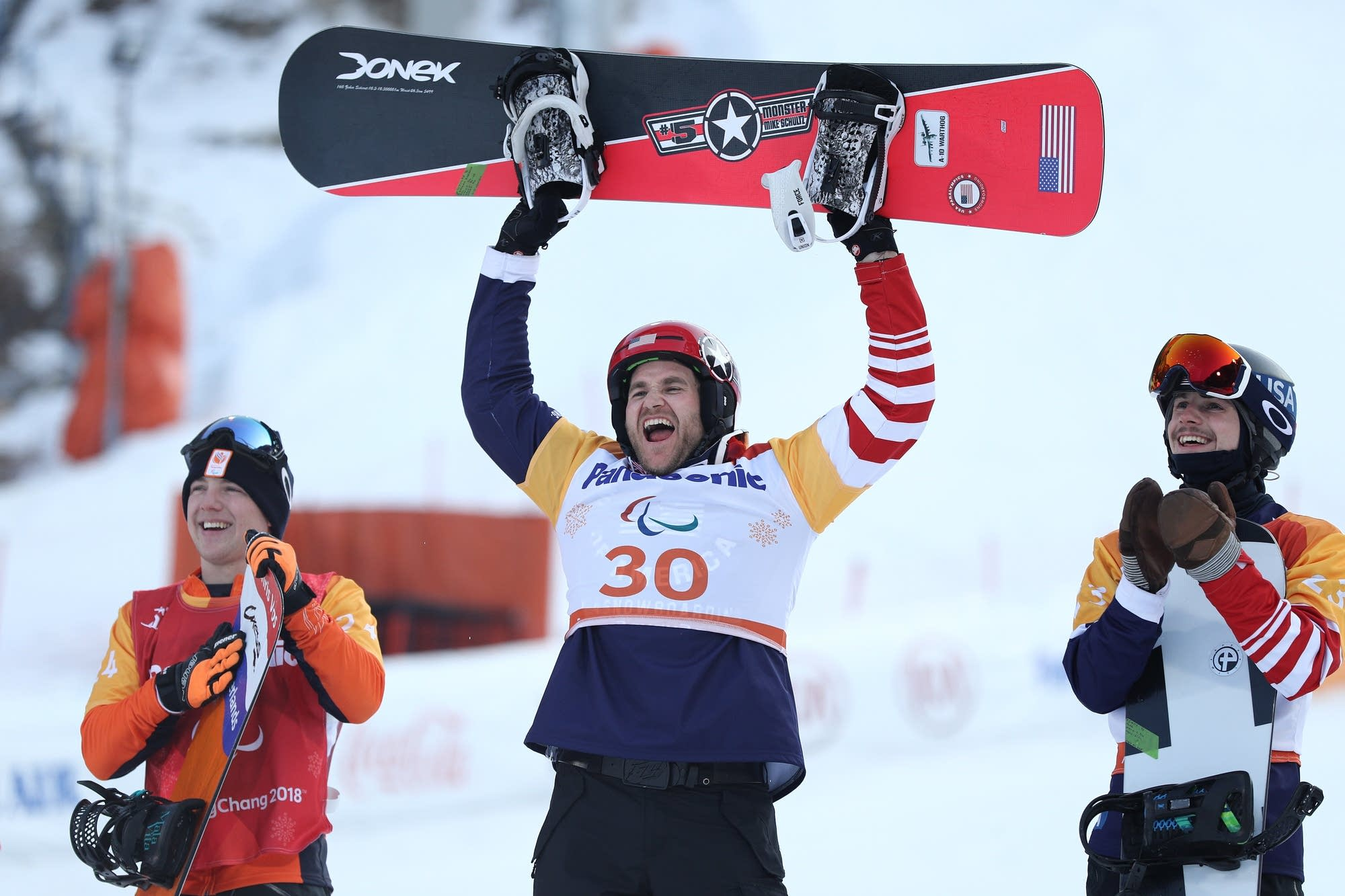 Mike Schultz of St. Cloud, Minn., celebrates after winning the gold medal.