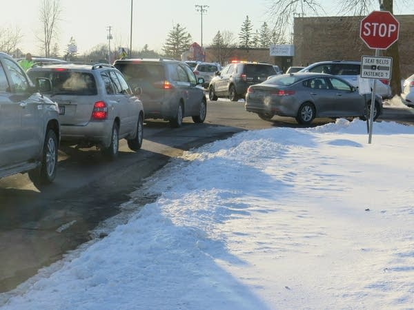 Cars lined up outside Orono Intermediate Elementary School