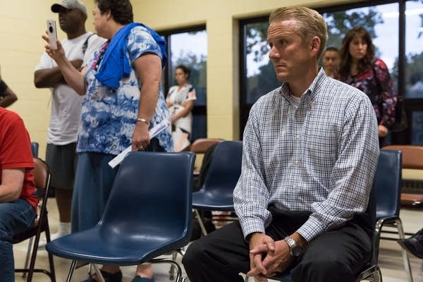 Drew Evans, the superintendent for the Minnesota BCA, sits quietly.