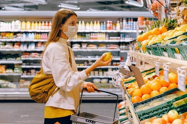 A woman grocery shopping