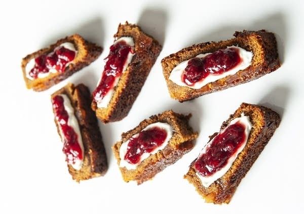 Ginger cake with cream and cranberry jam.