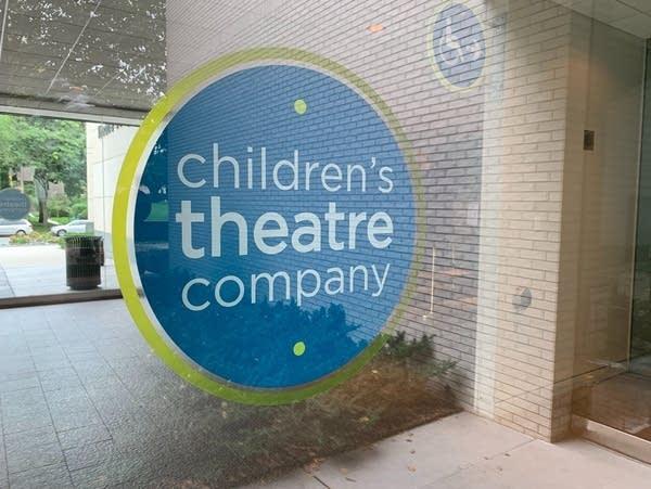 A blue and white sticker of the Children's Theatre Company logo