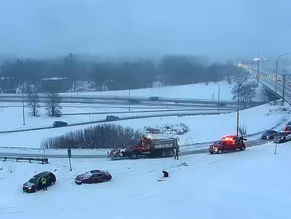 Crews respond to a crash amid snowy conditions
