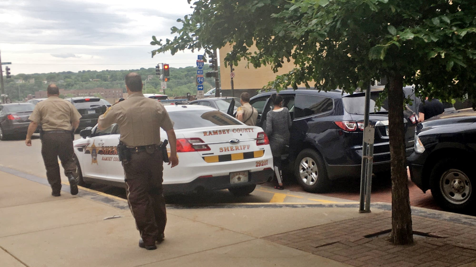 A juror from the Yanez trial is escorted from the courthouse by police.