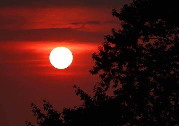A sun in the morning sky.
