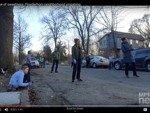 A group of people sing on the street
