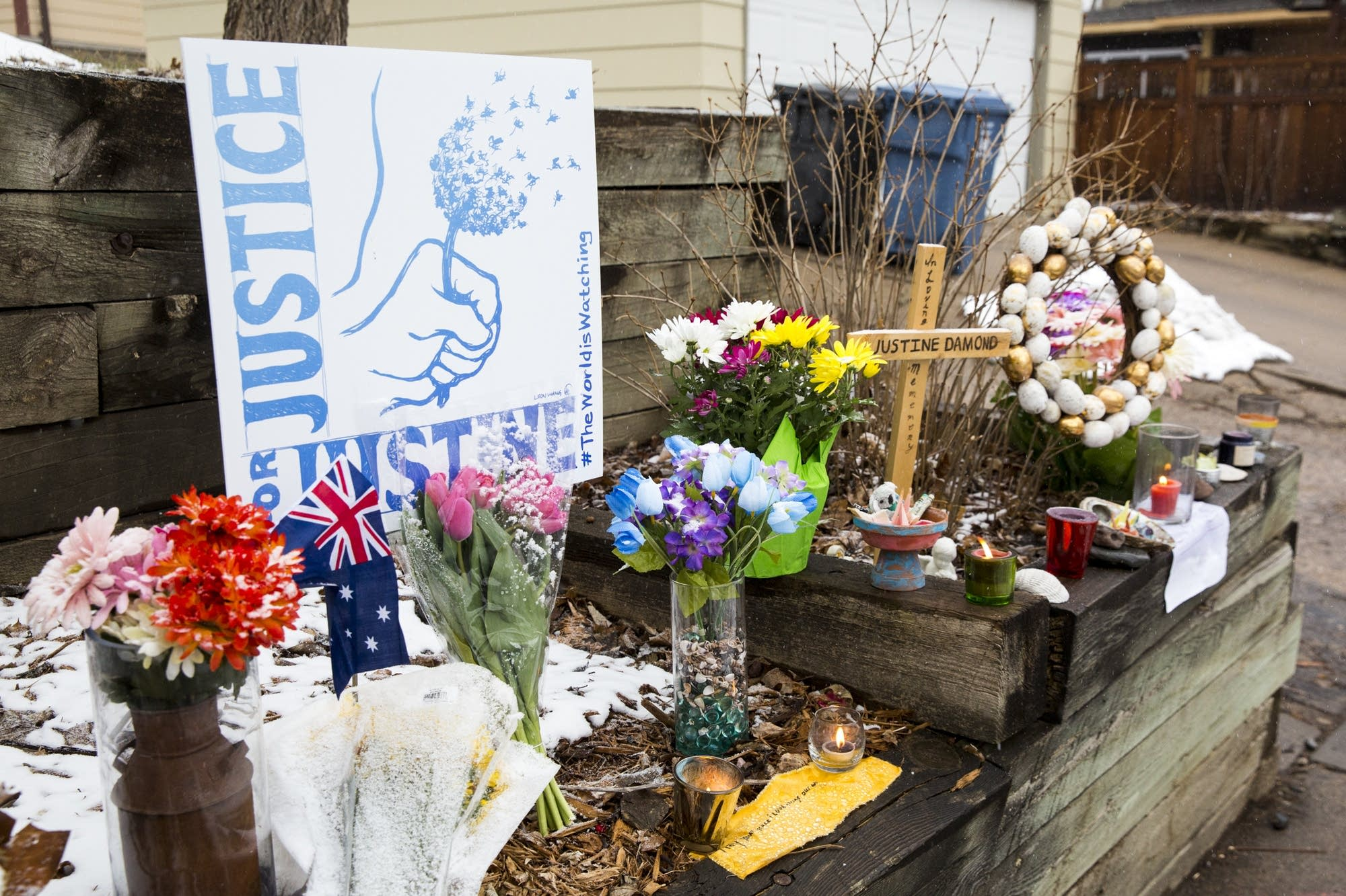 A fresh memorial for Justine Ruszczyk sits at the end of the alley