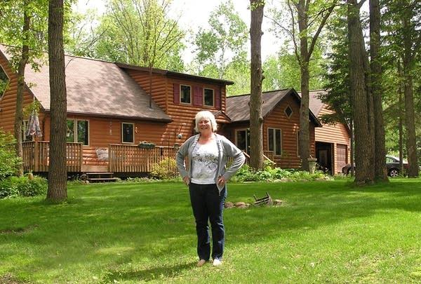 Jan Gertzen stands outside her home