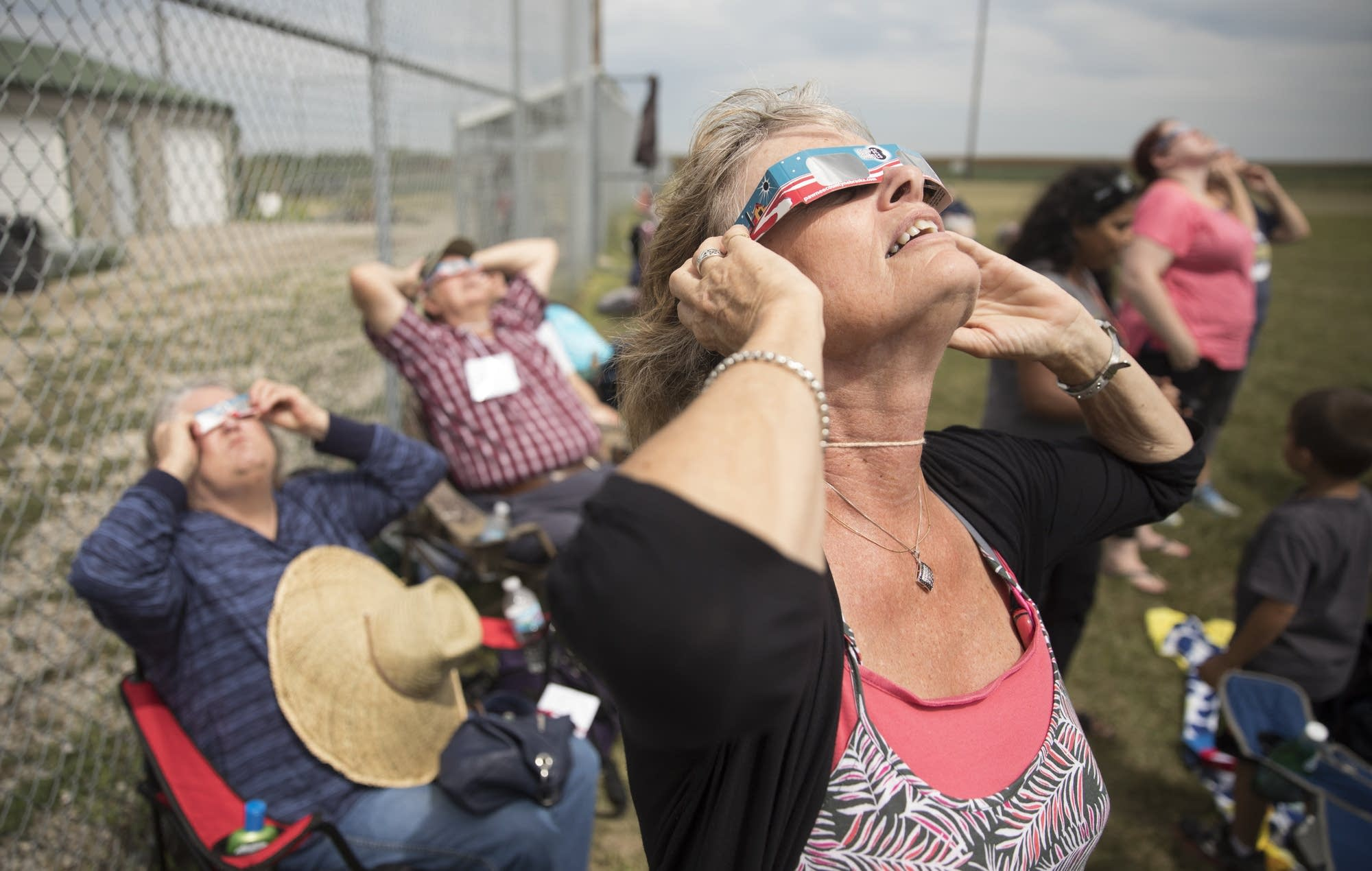 Dixie Jellum, of Mason City, Iowa watches the beginning of the eclipse.