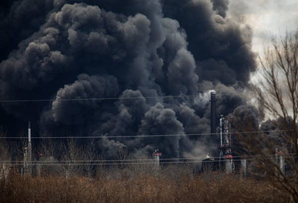 Black smoke rises from the site of the Husky Energy oil refinery.