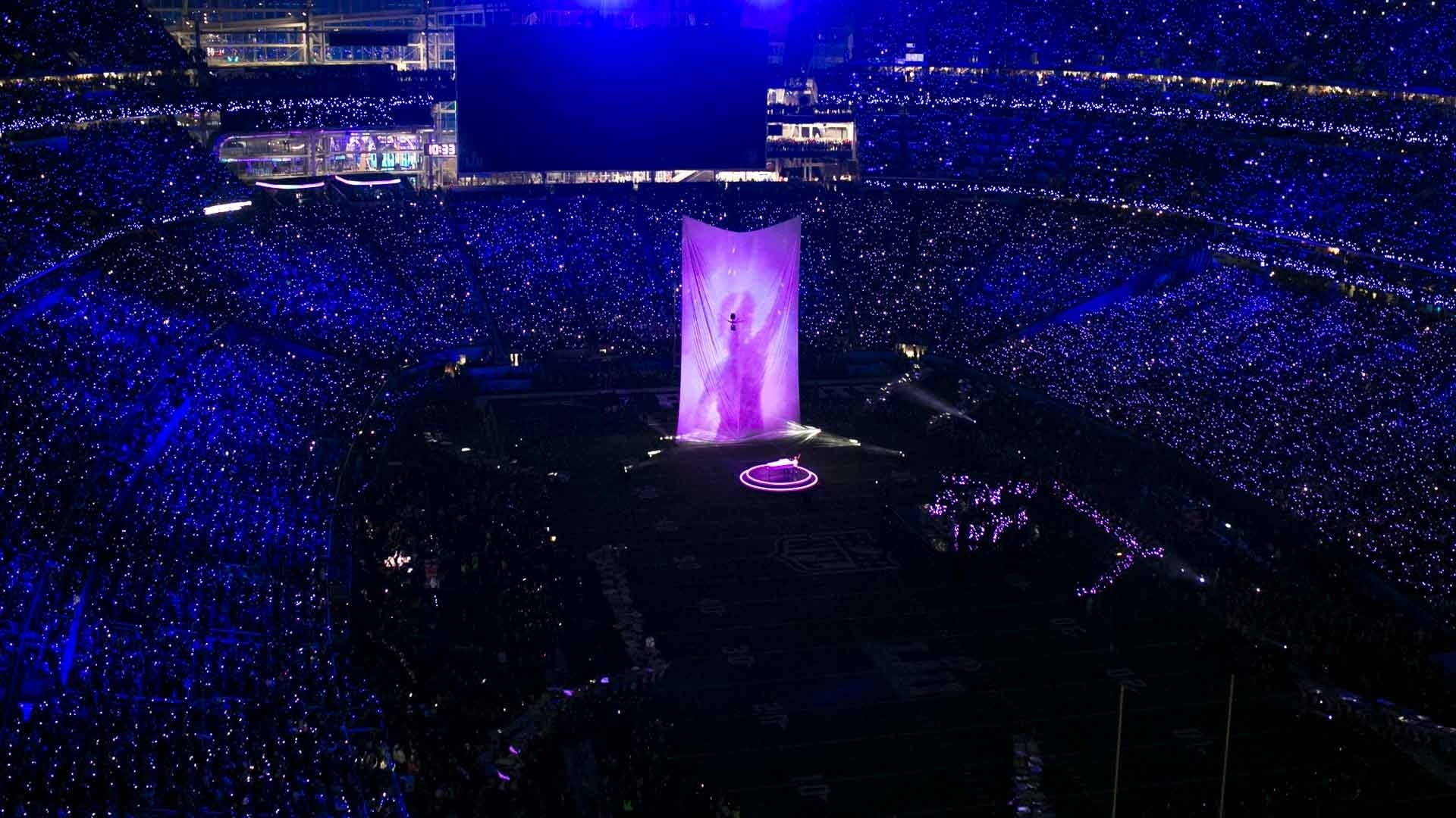 Justin Timberlake performs in front of a projection of Prince.