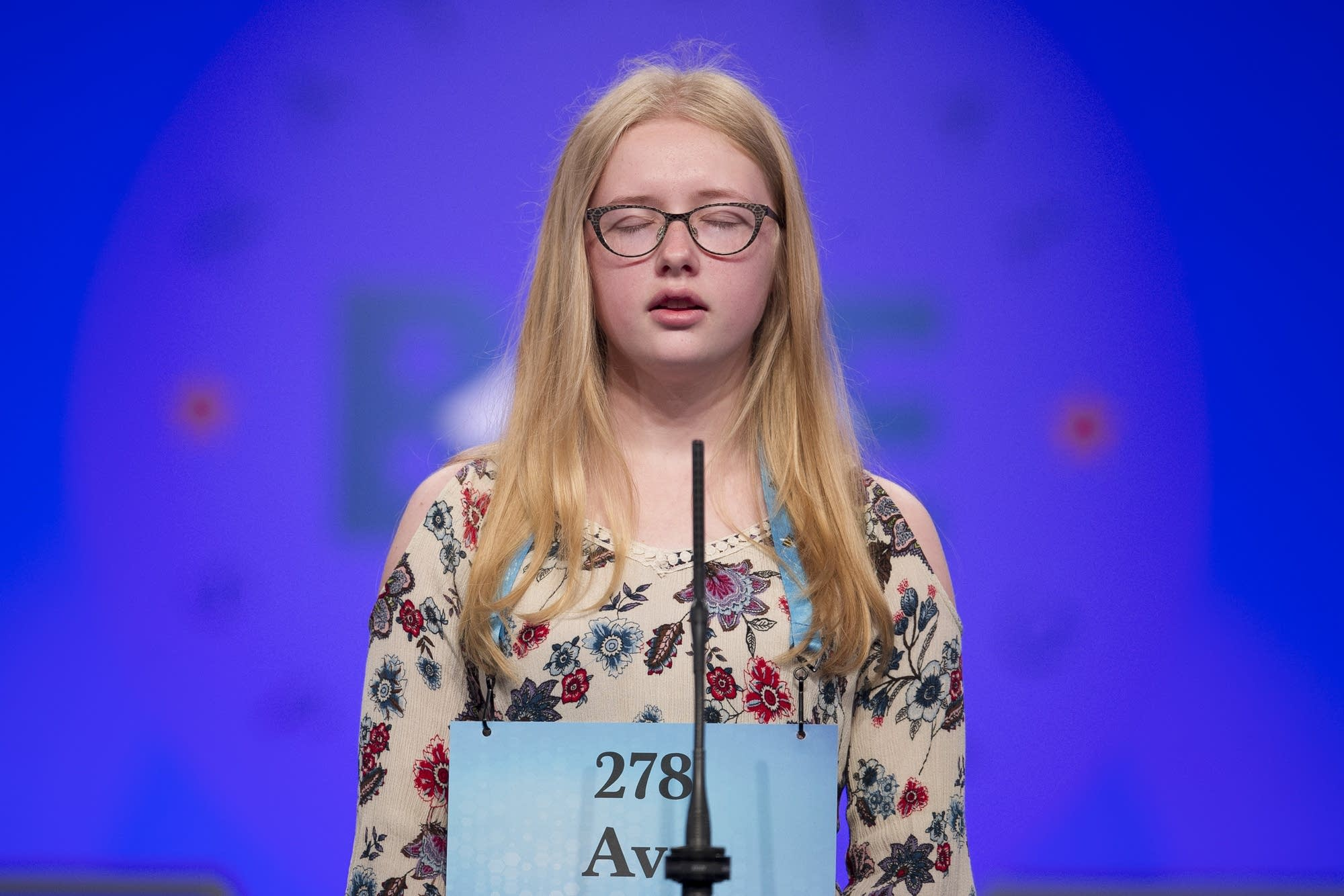 Ava Becken, 14, from Faribault, Minn., spells her word correctly.