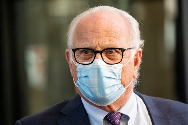 A man in a blue medical mask.
