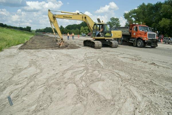Removing silt along Highway 169