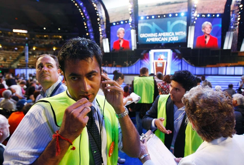 Actor Kal Penn works on the DNC floor