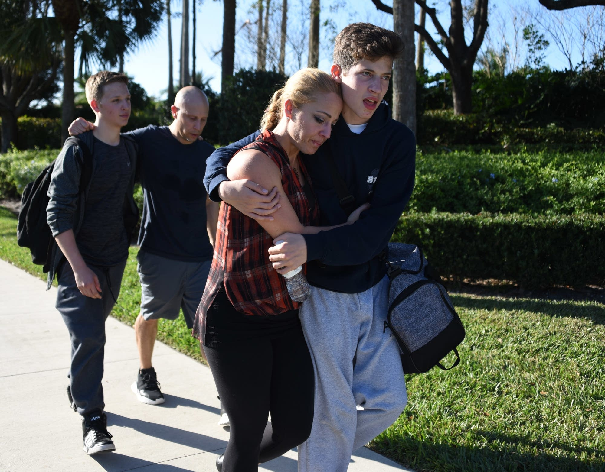 Students react following a shooting at a high school in Parkland, Florida.