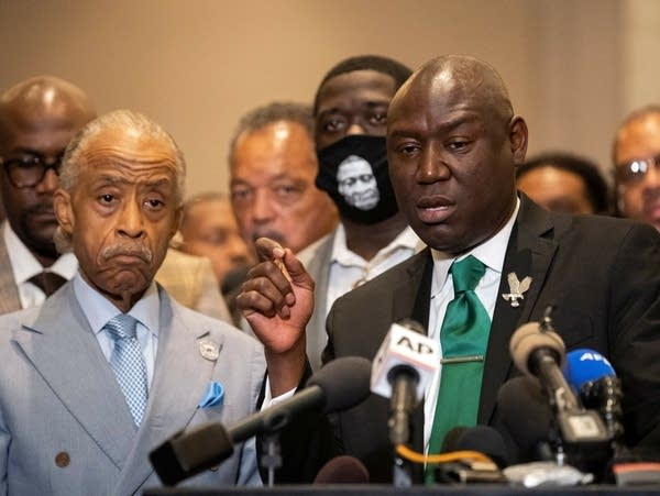 Attorney Ben Crump (right) and the Reverend Al Sharpton