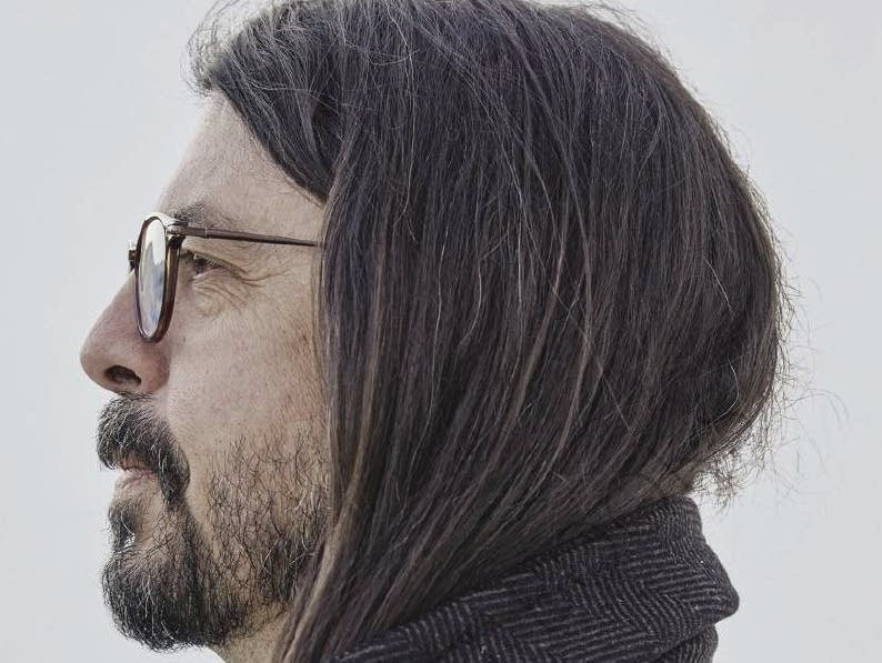 Profile photograph of Dave Grohl wearing glasses.